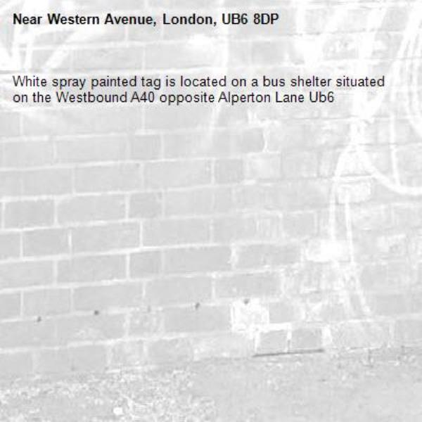 White spray painted tag is located on a bus shelter situated on the Westbound A40 opposite Alperton Lane Ub6 -Western Avenue, London, UB6 8DP