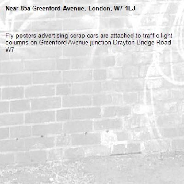 Fly posters advertising scrap cars are attached to traffic light columns on Greenford Avenue junction Drayton Bridge Road W7 -85a Greenford Avenue, London, W7 1LJ
