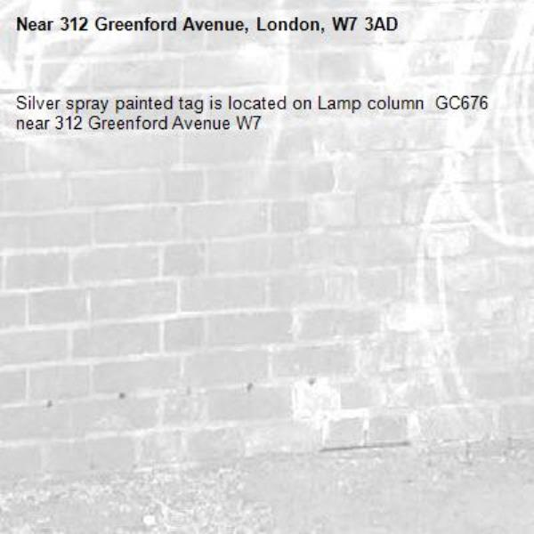 Silver spray painted tag is located on Lamp column  GC676 near 312 Greenford Avenue W7 -312 Greenford Avenue, London, W7 3AD