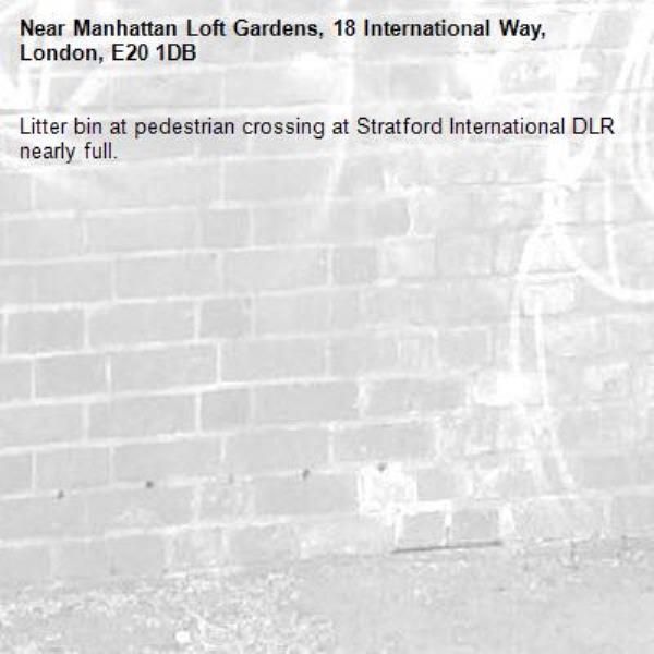 Litter bin at pedestrian crossing at Stratford International DLR nearly full.-Manhattan Loft Gardens, 18 International Way, London, E20 1DB