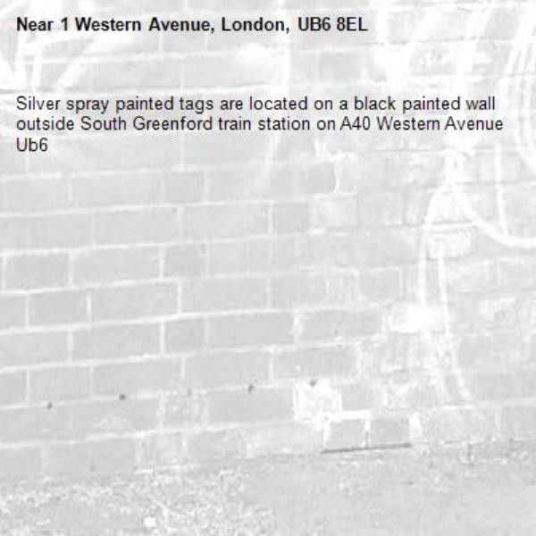 Silver spray painted tags are located on a black painted wall outside South Greenford train station on A40 Western Avenue Ub6 -1 Western Avenue, London, UB6 8EL