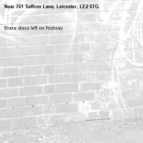 Brake discs left on footway.-761 Saffron Lane, Leicester, LE2 6TG