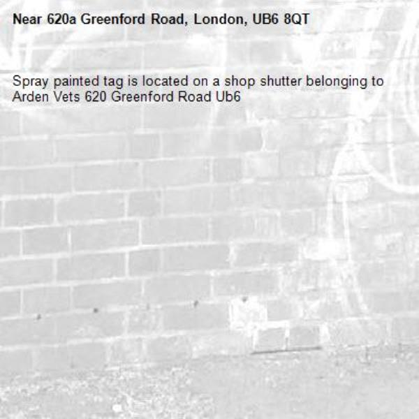 Spray painted tag is located on a shop shutter belonging to Arden Vets 620 Greenford Road Ub6 -620a Greenford Road, London, UB6 8QT