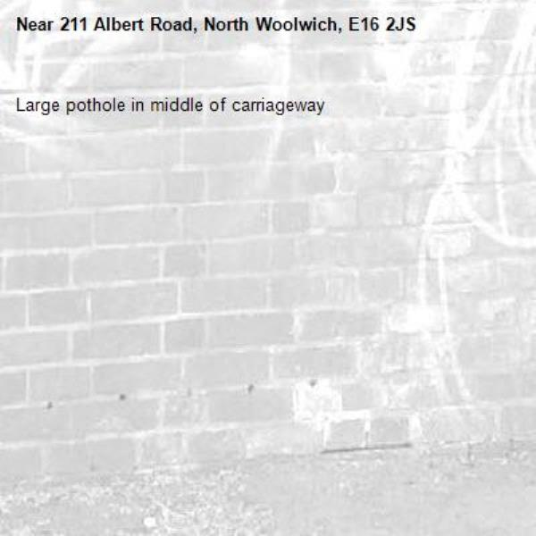Large pothole in middle of carriageway-211 Albert Road, North Woolwich, E16 2JS