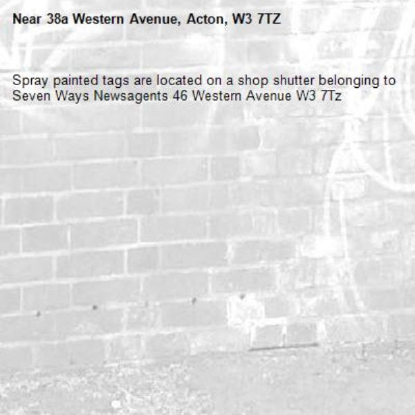 Spray painted tags are located on a shop shutter belonging to Seven Ways Newsagents 46 Western Avenue W3 7Tz -38a Western Avenue, Acton, W3 7TZ