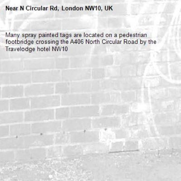 Many spray painted tags are located on a pedestrian footbridge crossing the A406 North Circular Road by the Travelodge hotel NW10-N Circular Rd, London NW10, UK