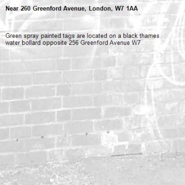Green spray painted tags are located on a black thames water bollard opposite 256 Greenford Avenue W7 -260 Greenford Avenue, London, W7 1AA
