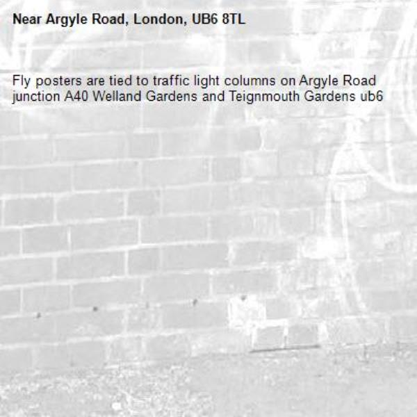 Fly posters are tied to traffic light columns on Argyle Road junction A40 Welland Gardens and Teignmouth Gardens ub6 -Argyle Road, London, UB6 8TL