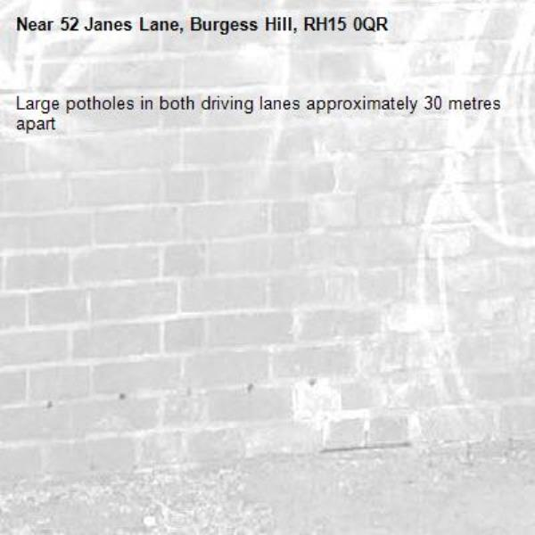 Large potholes in both driving lanes approximately 30 metres apart-52 Janes Lane, Burgess Hill, RH15 0QR