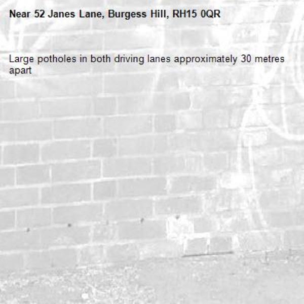 Large potholes in both driving lanes approximately 30 metres apart-52 Janes Lane, Burgess Hill, RH15 0QR