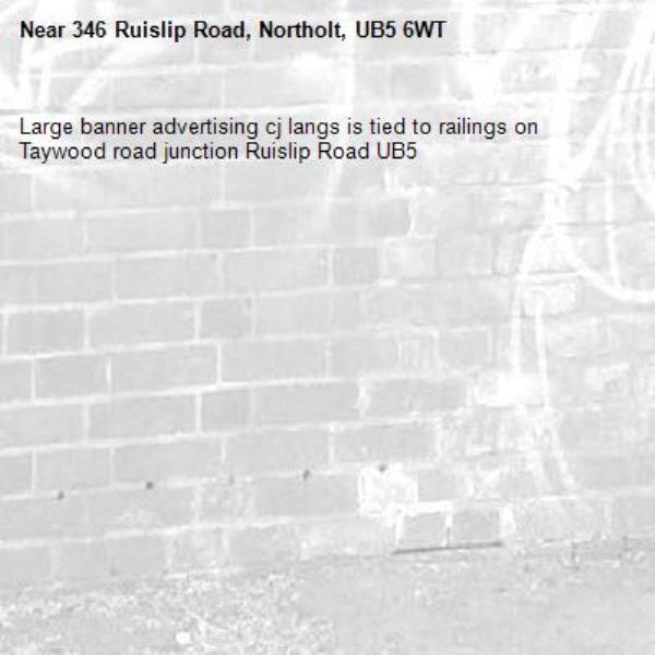 Large banner advertising cj langs is tied to railings on Taywood road junction Ruislip Road UB5 -346 Ruislip Road, Northolt, UB5 6WT