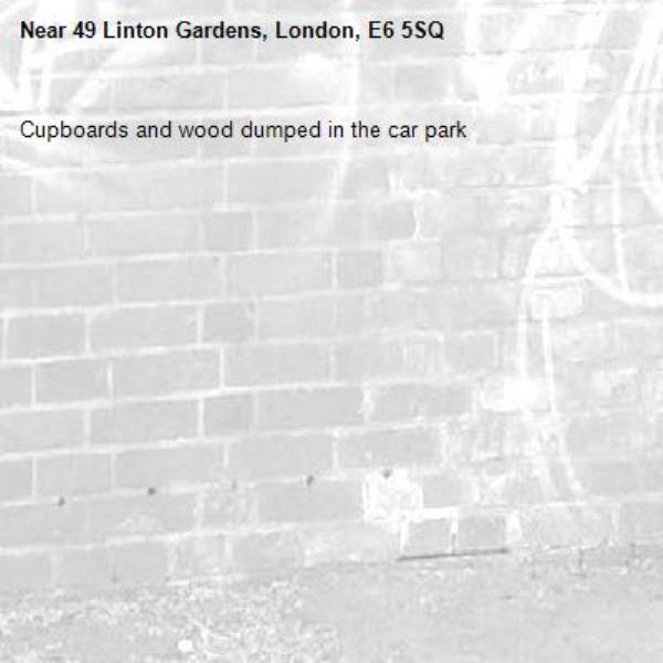 Cupboards and wood dumped in the car park-49 Linton Gardens, London, E6 5SQ