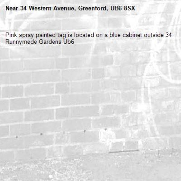 Pink spray painted tag is located on a blue cabinet outside 34 Runnymede Gardens Ub6 -34 Western Avenue, Greenford, UB6 8SX
