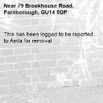 This has been logged to be reported to Asda for removal -79 Brookhouse Road, Farnborough, GU14 0DP
