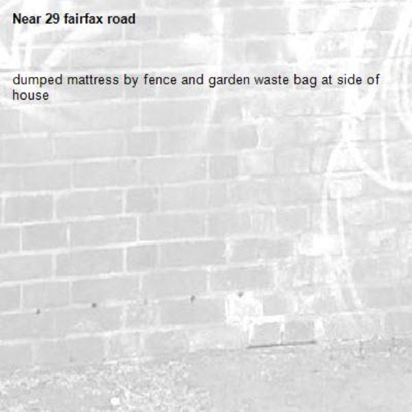 dumped mattress by fence and garden waste bag at side of house -29 fairfax road