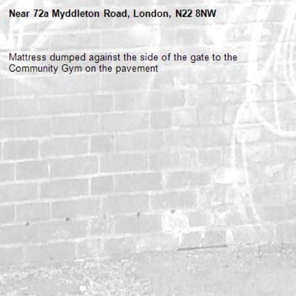 Mattress dumped against the side of the gate to the Community Gym on the pavement-72a Myddleton Road, London, N22 8NW