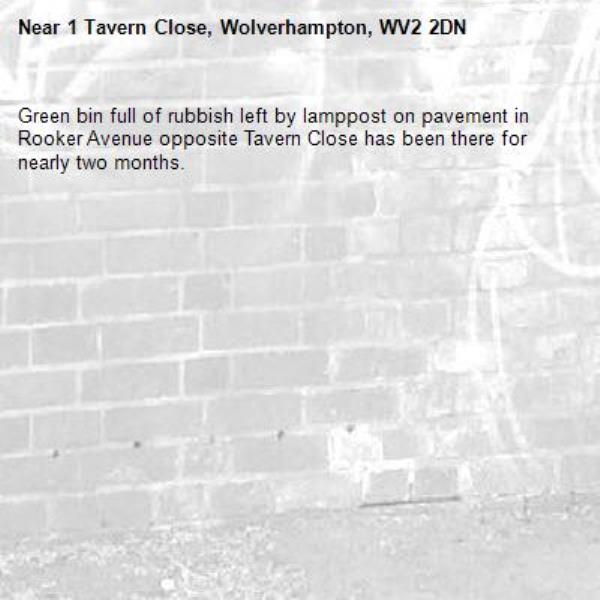 Green bin full of rubbish left by lamppost on pavement in Rooker Avenue opposite Tavern Close has been there for nearly two months.-1 Tavern Close, Wolverhampton, WV2 2DN