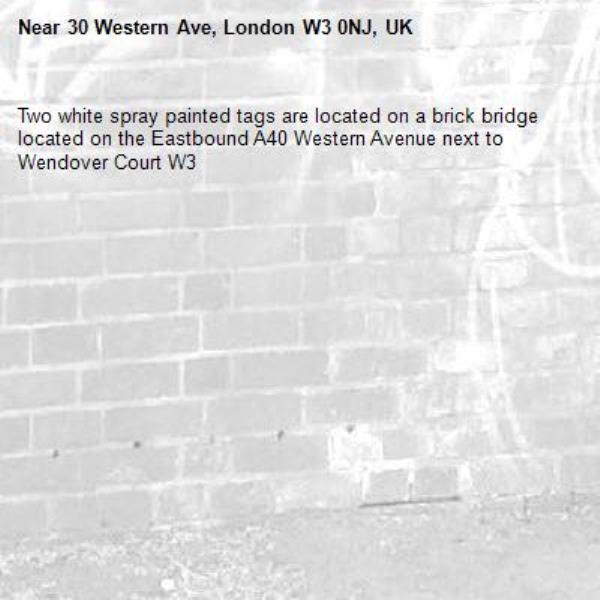 Two white spray painted tags are located on a brick bridge located on the Eastbound A40 Western Avenue next to Wendover Court W3-30 Western Ave, London W3 0NJ, UK