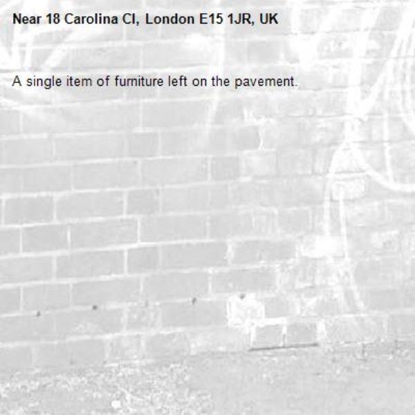 A single item of furniture left on the pavement. -18 Carolina Cl, London E15 1JR, UK