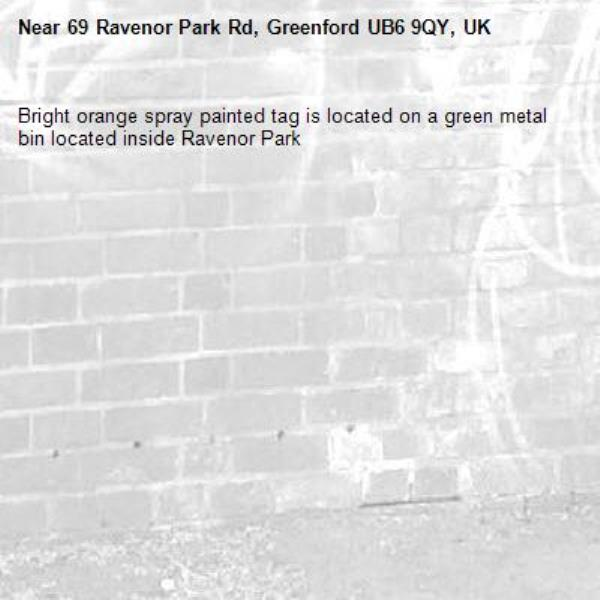 Bright orange spray painted tag is located on a green metal bin located inside Ravenor Park -69 Ravenor Park Rd, Greenford UB6 9QY, UK