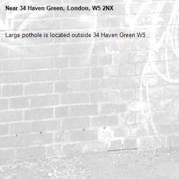 Large pothole is located outside 34 Haven Green W5 -34 Haven Green, London, W5 2NX