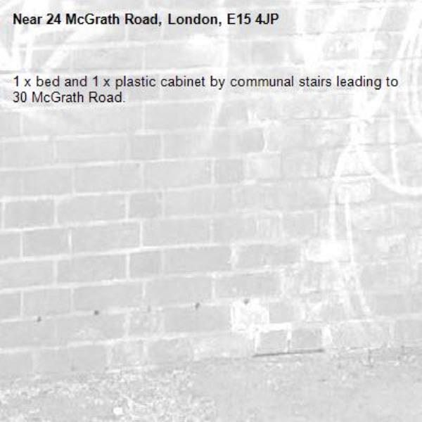 1 x bed and 1 x plastic cabinet by communal stairs leading to 30 McGrath Road.-24 McGrath Road, London, E15 4JP