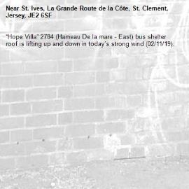 """Hope Villa"" 2784 (Hameau De la mare - East) bus shelter roof is lifting up and down in today's strong wind (02/11/19).-St. Ives, La Grande Route de la Côte, St. Clement, Jersey, JE2 6SF"