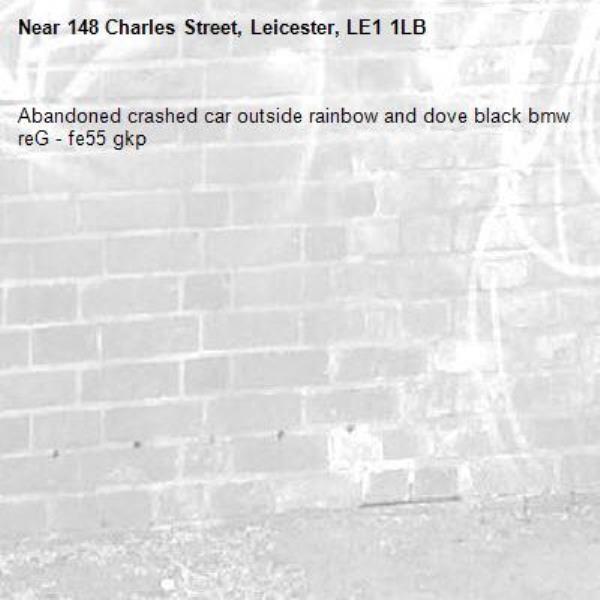 Abandoned crashed car outside rainbow and dove black bmw reG - fe55 gkp -148 Charles Street, Leicester, LE1 1LB