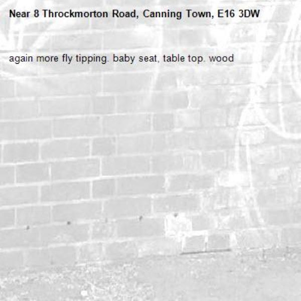 again more fly tipping. baby seat, table top. wood -8 Throckmorton Road, Canning Town, E16 3DW