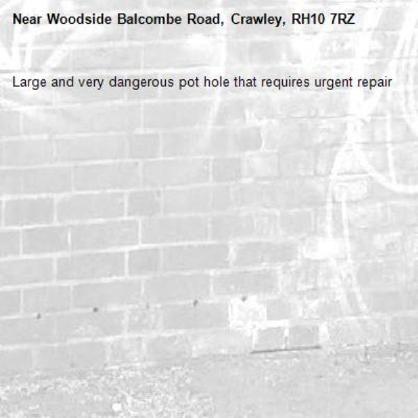 Large and very dangerous pot hole that requires urgent repair-Woodside Balcombe Road, Crawley, RH10 7RZ