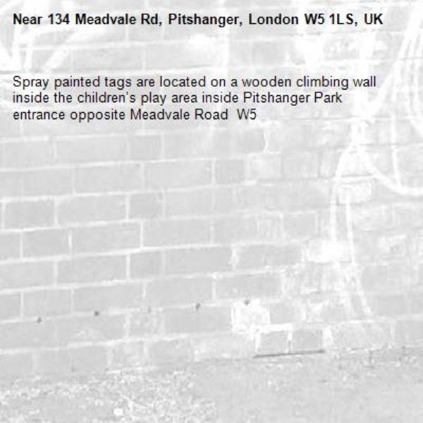 Spray painted tags are located on a wooden climbing wall inside the children's play area inside Pitshanger Park entrance opposite Meadvale Road  W5-134 Meadvale Rd, Pitshanger, London W5 1LS, UK