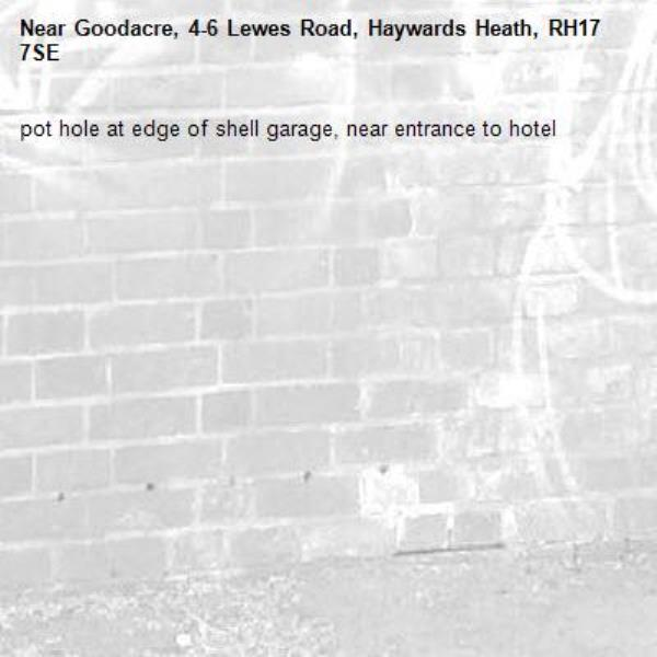 pot hole at edge of shell garage, near entrance to hotel-Goodacre, 4-6 Lewes Road, Haywards Heath, RH17 7SE