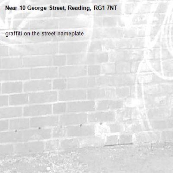 graffiti on the street nameplate   -10 George Street, Reading, RG1 7NT