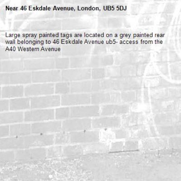 Large spray painted tags are located on a grey painted rear wall belonging to 46 Eskdale Avenue ub5- access from the A40 Western Avenue -46 Eskdale Avenue, London, UB5 5DJ
