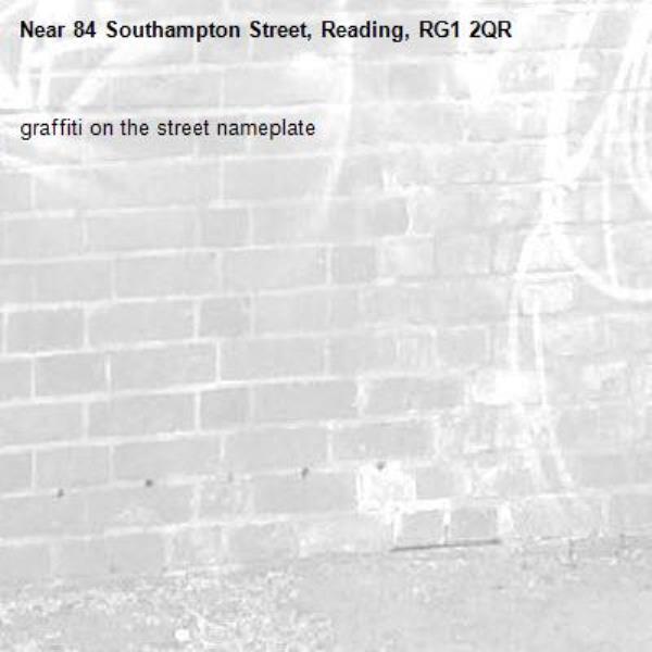 graffiti on the street nameplate -84 Southampton Street, Reading, RG1 2QR
