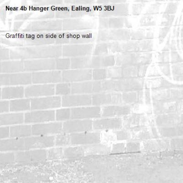 Graffiti tag on side of shop wall-4b Hanger Green, Ealing, W5 3BJ