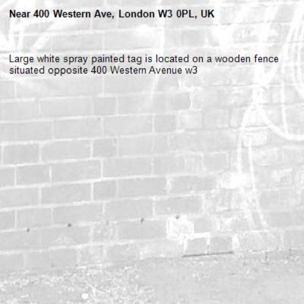 Large white spray painted tag is located on a wooden fence situated opposite 400 Western Avenue w3-400 Western Ave, London W3 0PL, UK