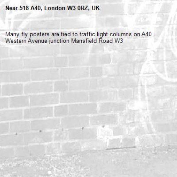 Many fly posters are tied to traffic light columns on A40 Western Avenue junction Mansfield Road W3-518 A40, London W3 0RZ, UK
