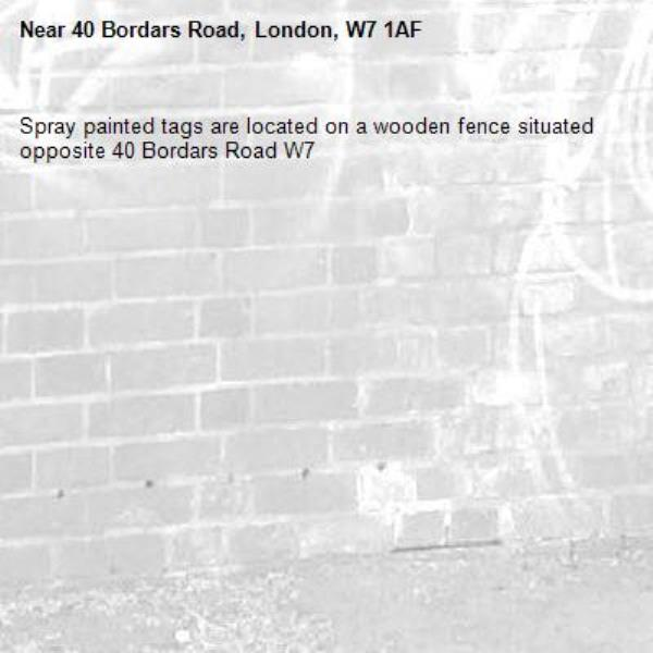 Spray painted tags are located on a wooden fence situated opposite 40 Bordars Road W7-40 Bordars Road, London, W7 1AF