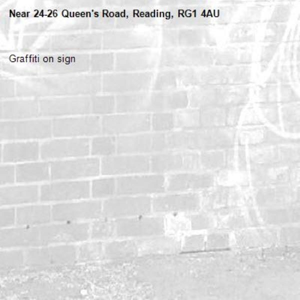 Graffiti on sign-24-26 Queen's Road, Reading, RG1 4AU