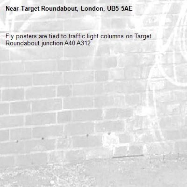Fly posters are tied to traffic light columns on Target Roundabout junction A40 A312-Target Roundabout, London, UB5 5AE