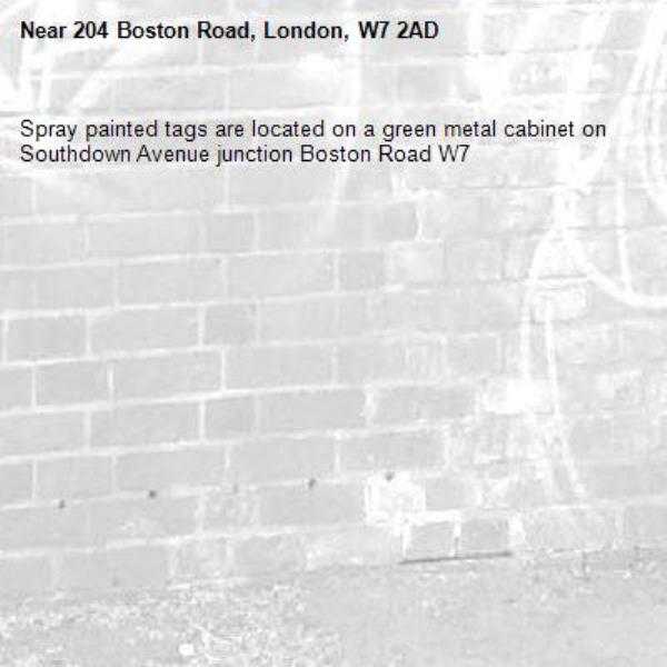 Spray painted tags are located on a green metal cabinet on Southdown Avenue junction Boston Road W7 -204 Boston Road, London, W7 2AD