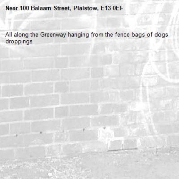 All along the Greenway hanging from the fence bags of dogs droppings -100 Balaam Street, Plaistow, E13 0EF