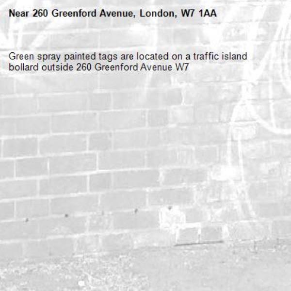 Green spray painted tags are located on a traffic island bollard outside 260 Greenford Avenue W7 -260 Greenford Avenue, London, W7 1AA