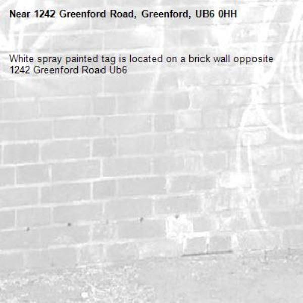White spray painted tag is located on a brick wall opposite 1242 Greenford Road Ub6 -1242 Greenford Road, Greenford, UB6 0HH