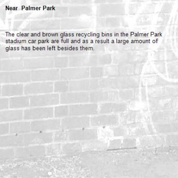 The clear and brown glass recycling bins in the Palmer Park stadium car park are full and as a result a large amount of glass has been left besides them.- Palmer Park