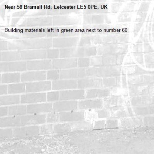 Building materials left in green area next to number 60 -58 Bramall Rd, Leicester LE5 0PE, UK