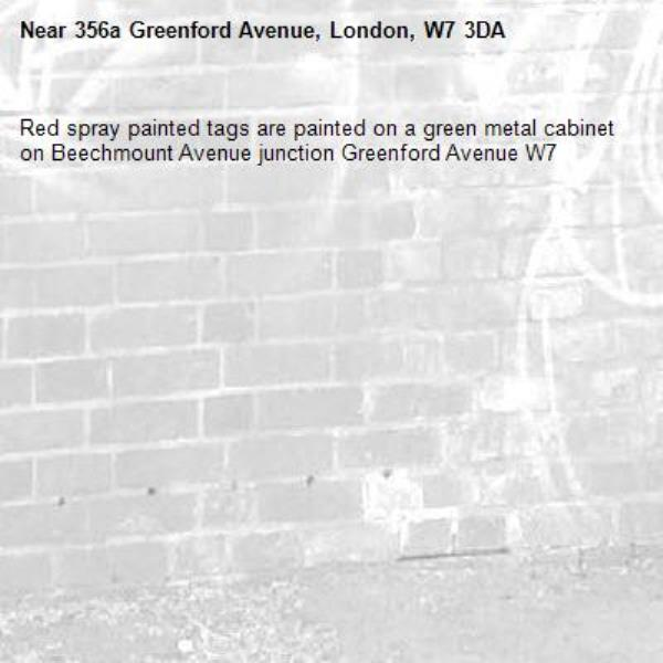 Red spray painted tags are painted on a green metal cabinet on Beechmount Avenue junction Greenford Avenue W7 -356a Greenford Avenue, London, W7 3DA