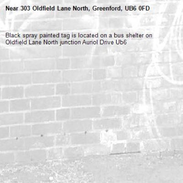 Black spray painted tag is located on a bus shelter on Oldfield Lane North junction Auriol Drive Ub6 -303 Oldfield Lane North, Greenford, UB6 0FD