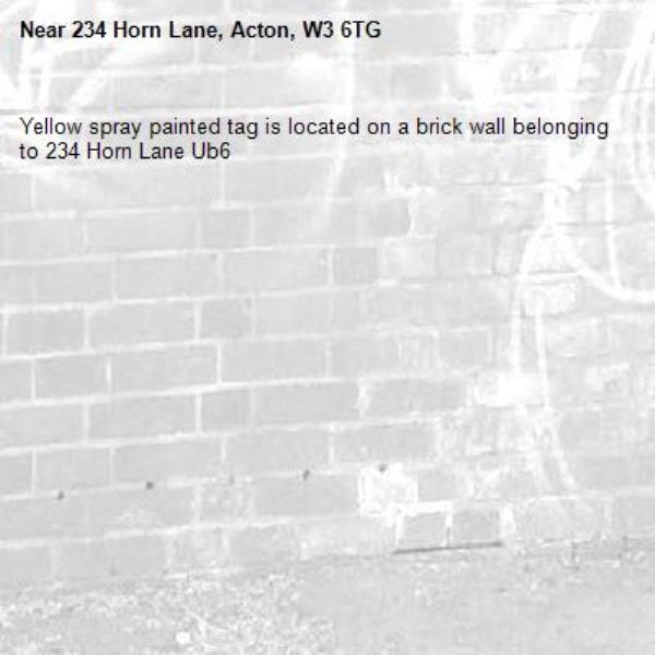 Yellow spray painted tag is located on a brick wall belonging to 234 Horn Lane Ub6 -234 Horn Lane, Acton, W3 6TG